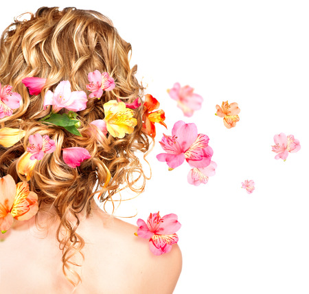 Foto de Hairstyle with colorful flowers  Haircare concept  Backside view - Imagen libre de derechos