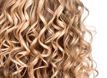 Photo pour Wavy curly blonde hair closeup  Texture of permed hair - image libre de droit