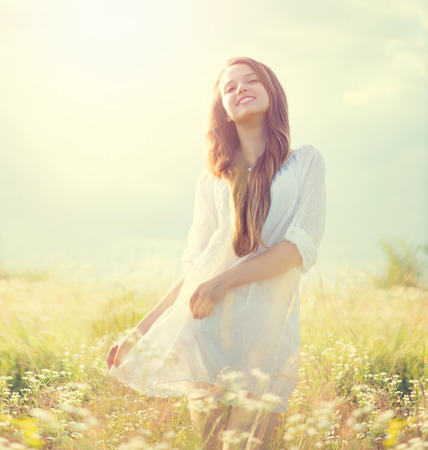 Photo for Beauty summer girl outdoors enjoying nature - Royalty Free Image