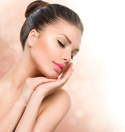 Foto de Beauty Spa Woman Portrait  Beautiful Girl Touching her Face - Imagen libre de derechos