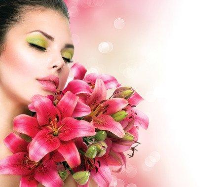 Photo for Beauty Girl with Lilly Flowers bouquet - Royalty Free Image