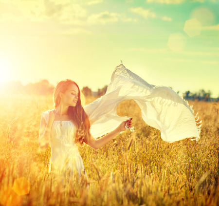 Photo for Beauty girl in white dress on summer field enjoying nature - Royalty Free Image