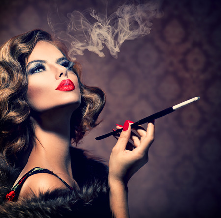 Foto de Retro Woman with Mouthpiece  Vintage Styled Beautiful Lady - Imagen libre de derechos