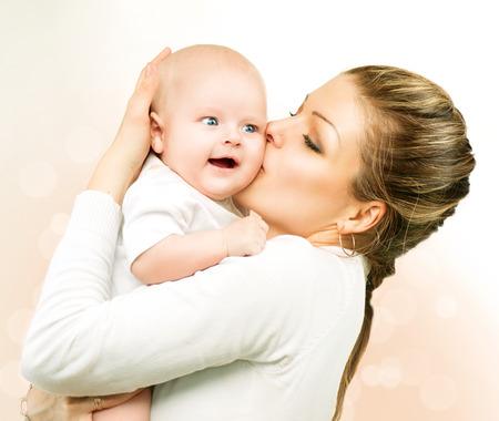 Foto de Mother and baby kissing and hugging  Mom with her child - Imagen libre de derechos
