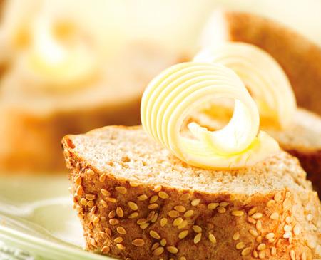 Foto de Butter on a Slice of Bread  Butter Rolls  Healthy Breakfast - Imagen libre de derechos