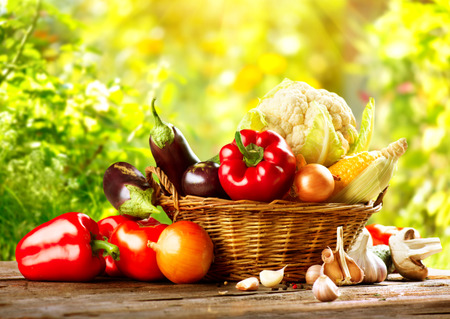 Foto de Fresh Organic Bio Vegetable in a Basket over Nature Background - Imagen libre de derechos