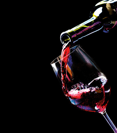 Photo pour Wine  Red wine pouring into a wine glass - image libre de droit