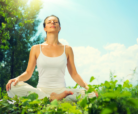 Photo for Young woman doing yoga exercises outdoors - Royalty Free Image