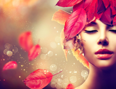 Foto de Autumn Woman. Fall. Girl with colourful autumn leaves hairstyle - Imagen libre de derechos