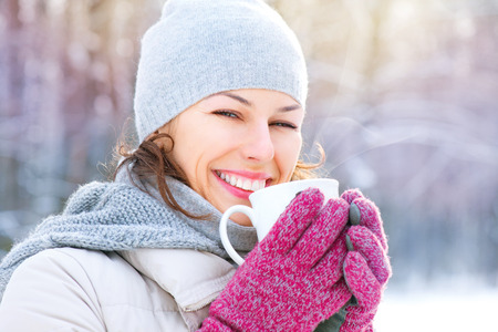 Photo for Beautiful happy smiling winter woman with hot drink - Royalty Free Image