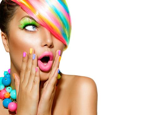 Photo pour Surprised Woman with Colorful Makeup, Hair and Nail polish - image libre de droit
