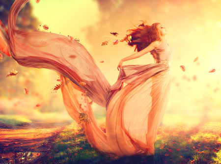 Photo pour Autumn fantasy girl, fairy in blowing chiffon dress - image libre de droit