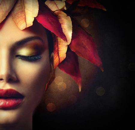 Photo pour Fantasy Autumn Woman with Colourful Autumn Leaves Hairstyle - image libre de droit