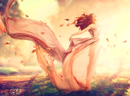 Foto de Autumn fantasy girl, fairy in blowing chiffon dress - Imagen libre de derechos