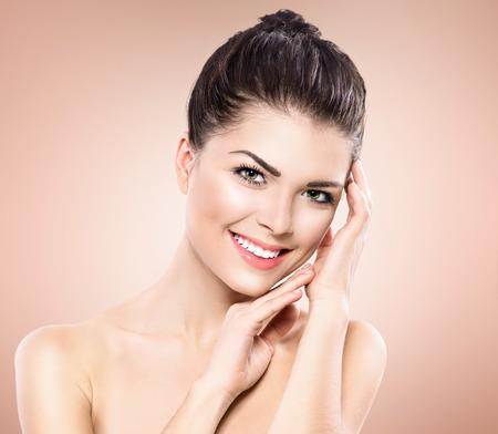 Photo pour Beauty Portrait. Beautiful Spa Girl Touching her Face - image libre de droit