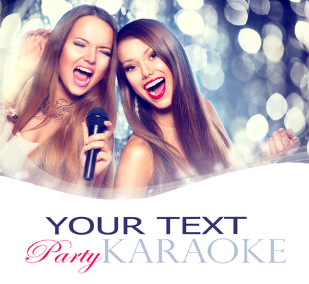 Photo for Karaoke. Beauty girls with a microphone singing and dancing - Royalty Free Image