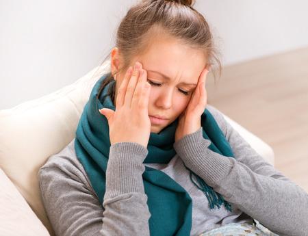 Foto de Headache. Young Woman having Headache - Imagen libre de derechos
