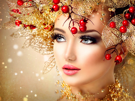Foto de Christmas fashion model girl with golden hairstyle and makeup - Imagen libre de derechos