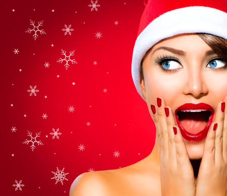 Photo for Christmas Woman. Beauty Model Girl in Santa Hat over Red - Royalty Free Image