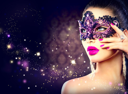 Photo for Sexy woman wearing carnival mask over holiday dark background - Royalty Free Image
