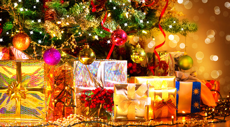 Photo pour Holiday Christmas scene. Gifts under the Christmas tree - image libre de droit