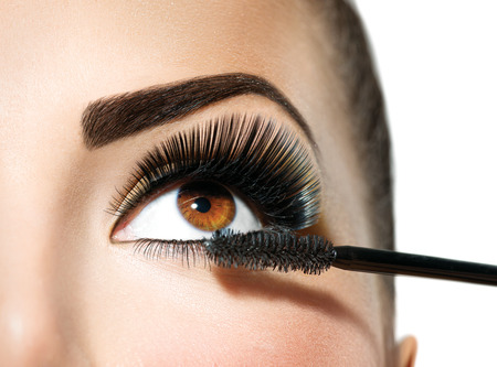 Photo for Mascara applying. Long lashes closeup. Makeup for brown eyes - Royalty Free Image