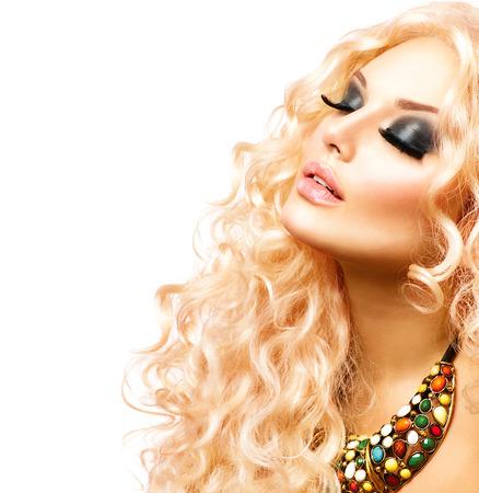 Foto de Beauty Girl With Healthy Long Curly Hair. Blonde Woman Portrait - Imagen libre de derechos