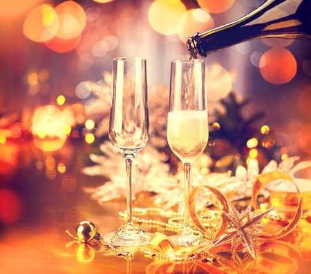 Photo pour Christmas holiday decorated table. Champagne glasses - image libre de droit