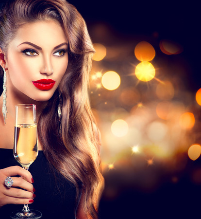 Foto de Sexy girl with glass of champagne over holiday background - Imagen libre de derechos
