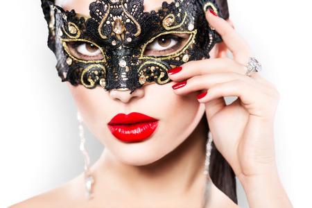 Foto de Beauty model woman wearing masquerade carnival mask - Imagen libre de derechos