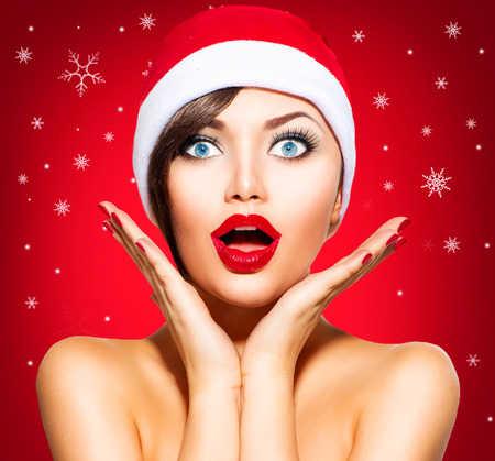 Photo for Christmas Surprised Winter Woman. Beauty Model Girl in Santa Hat - Royalty Free Image