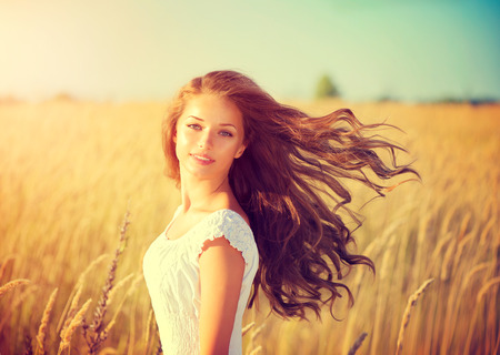 Photo for Beautiful teenage model girl in white dress enjoying nature - Royalty Free Image
