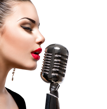 Photo for Singing woman with retro microphone - Royalty Free Image