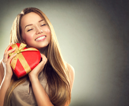 Photo for Beauty happy girl with Valentine gift box - Royalty Free Image