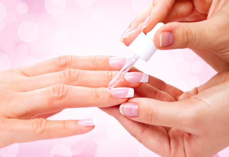 Photo pour Manicure, hands spa cuticle oil. Beautiful woman hands closeup - image libre de droit