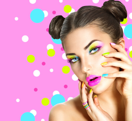 Photo for Beauty girl with colorful makeup, nail polish and accessories - Royalty Free Image