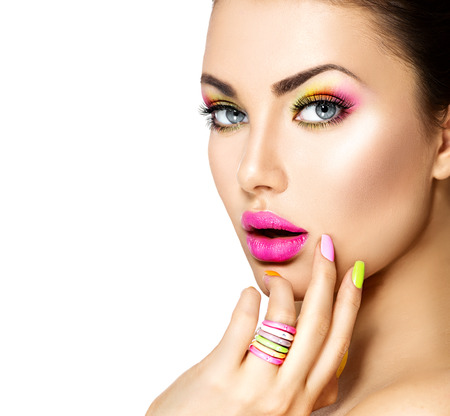 Photo pour Beauty girl with colorful makeup, nail polish and accessories - image libre de droit