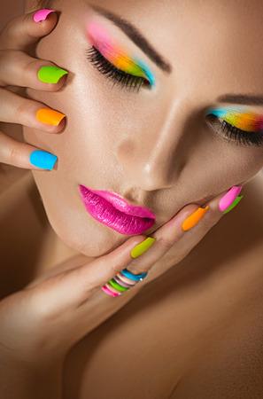 Foto de Sexy girl portrait with vivid makeup and colorful nailpolish - Imagen libre de derechos