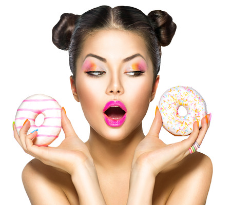 Photo for Beauty model girl taking colorful donuts. Dieting concept - Royalty Free Image
