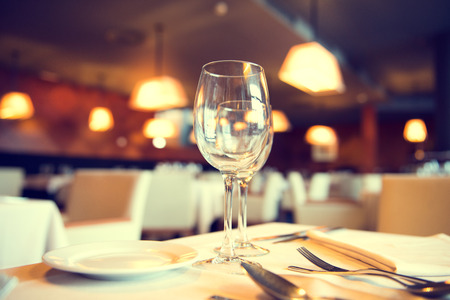 Photo for Served dinner table in a restaurant. Restaurant interior - Royalty Free Image