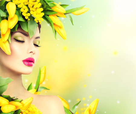 Photo pour Spring woman. Beauty spring model girl with flowers hair style - image libre de droit