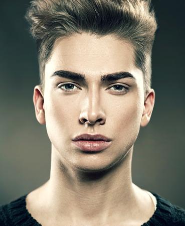 Photo pour Handsome young fashion model man portrait. Attractive guy - image libre de droit