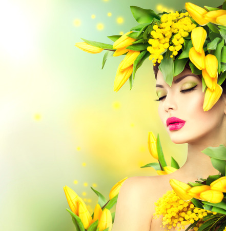 Foto de Spring woman. Beauty spring model girl with flowers hair style - Imagen libre de derechos