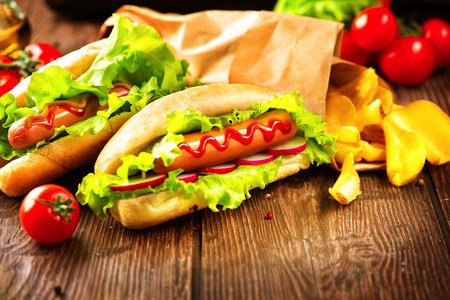 Photo for Hot dog. Grilled hot dogs with ketchup on a wooden table - Royalty Free Image