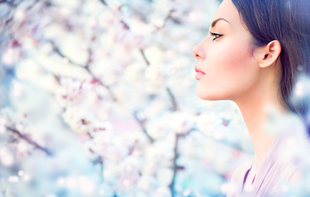 Photo for Spring fashion girl outdoor portrait in blooming trees - Royalty Free Image