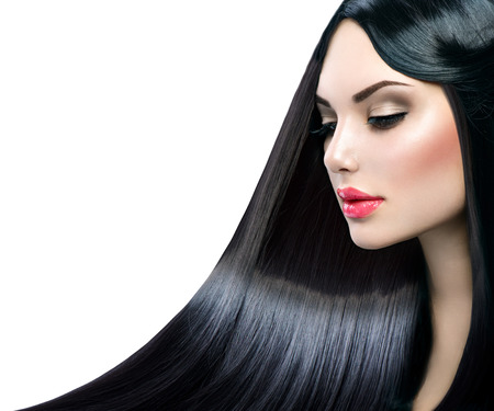 Foto de Beautiful model girl with healthy long straight shiny hair - Imagen libre de derechos