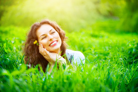 Photo for Beautiful young woman outdoors enjoying nature - Royalty Free Image