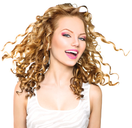 Photo for Beauty model girl with blowing blonde curly hair - Royalty Free Image