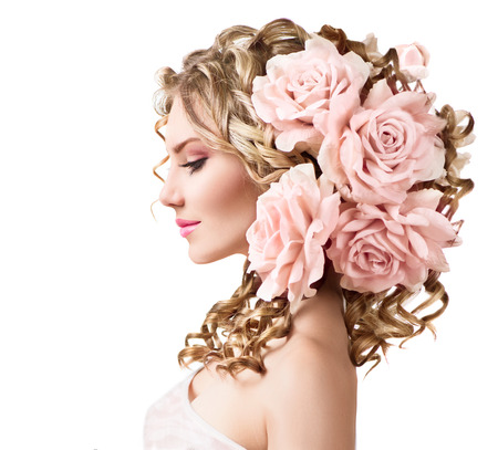Photo pour Beauty girl with rose flowers hairstyle isolated on white - image libre de droit