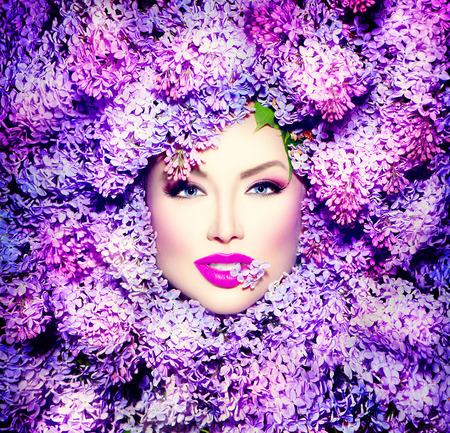 Photo pour Beauty fashion model girl with lilac flowers hairstyle - image libre de droit